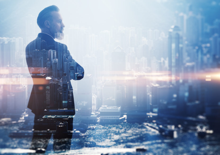 Double exposure photo of a businessman and modern city. Horizontal